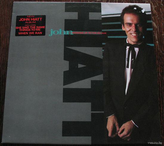 "John Hiatt ""Warming Up To The Ice Age"" LP, 1985"