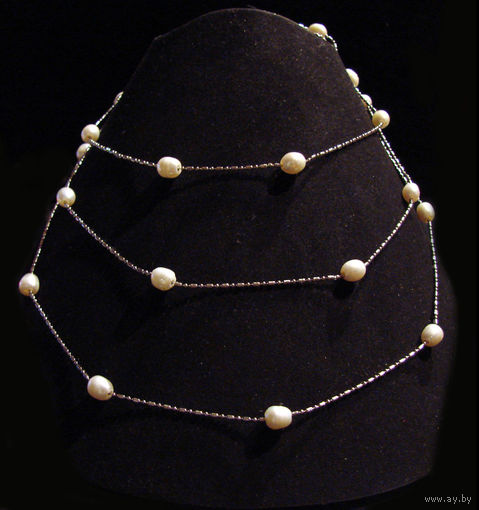 Ожерелье-браслет из натурального жемчуга, новое, длинное 122см. Можно носить не только в качестве длинных бус, но и в виде колье в 3-4 ряда либо как многополосный браслет. Металл - гиппоаллергенный юв